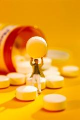 man-holding-pill-s