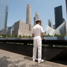 Ensign Kenneth Janson at edge of WTC Memorial, after participating in re-enlistment and promotion Ceremony as part of Fleet Week, NYC.