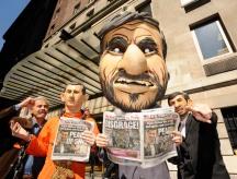 Group of protestors wearing masks, protesting against Mahmoud Ahmadinejad staying at Warwick Hotel, NYC
