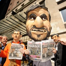 Group of protestors wearing masks, protesting against Mahmoud Ahmadinejad staying at Warwick Hotel, NYC