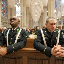 Officers praying during St. Patrick's Day mass in St. Patrick's Cathedral.