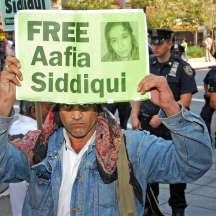 Protester holding sign at Aafia Siddiqui sentencing at US District Court, 500 Pearl, NYC.