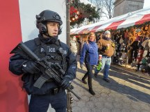 NYPD armed with automatic weapons outside Columbus Circle Holiday Shopping area, NYC.