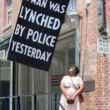 Flag outside Jack Shaman Gallery, work of artist Dread Scott, which says: A Man Was Lynched By Police Yesterday, West 20th St. NYC.
