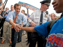 Mayoral candidate Anthony Weiner campaigning today, corner of 125th Street and Malcolm X Blvd, NYC.