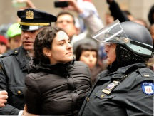 Protester being arrested at Occupy Wall Street demonstration at corner of William St. and Pine St., NYC