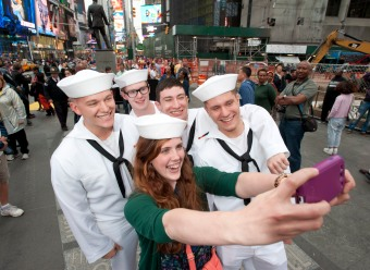 052214-SELFIE-DM-1 (#selfiewithasailor) People doing selfless with sailors in Times Square during Fleet Week, NYC. Far left: S.N. Rogers, center woman: Caitlin Teters, far right: S.N. Murray David McGlynn 5/22/14