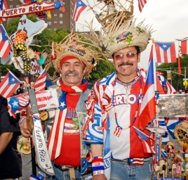 061210-PUERTORICANFESTIVAL-DM-2 Two brothers, Jose Wilson Medina (left) and Felix Medina (right) showing off their outfits at the Puerto Rican Festival on 116th Street, NYC. They have been coming to NYC PR festivals for 32 years. David McGlynn 6/12/10
