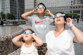 082117-ECLIPSE-DM-1 People watching eclipse in battery park City area, NYC. David McGlynn 8/21/17