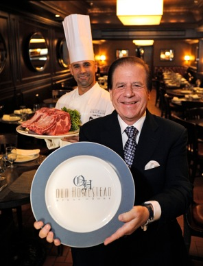 091412-HOMESTEAD-DM-5.jpg Marc Sherry (front), Co-owner of Old Homestead Restaurant, holding showplate, and Executive Chef Luis Rivera (back left) photographed inside main dining room, 56 Ninth Ave, NYC. (NOTE: Meat shown is NOT Kobe) David McGlynn 9/14/12