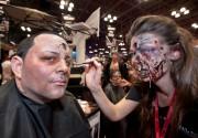 101013-COMICCON-DM-46 Makeup artist applying horror makeup to man at Comic Con, Jacob Javits Center, NYC. David McGlynn 10/10/13
