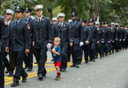 101117-FDNY-MEMORIAL-DM-14 Young boy walking with firefighter father at FDNY Annual Memorial Service, Fireman's Monument, 100th Street & Riverside Drive, NYC. David McGlynn 10/11/17