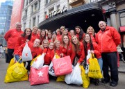 112312-BLACKFRIDAY-DM-20.jpg Members of women's soccer team visiting from New Foundland, Canada holding many shopping bags outside Macy's Herald Square, NYC. Far left: Constable Jake Stanford. On far left: Doug redmond, president of New Foundland Soccer Association. David McGlynn 11/23/12
