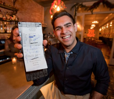 120913-TIPSFORJESUS-DM-2 Aruj Dhawan, a waiter at Bo's Restaurant, who received a $1,000 tip from the man/entity known as 'Tips For Jesus', located at 6 West 24th Street, NYC. David McGlynn 12/9/13