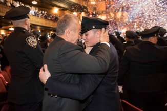 122818-NYPD-GRADUATION-DM-5 Graduate Christopher Senft hugging his grandfather retired detective Anthony Senft who received a medal of honor from NYPD for being injured in 1982 as part of bomb squad. At the NYPD Graduation Ceremony at Beacon Theatre, Broadway @ West 74th St , NYC. David McGlynn 12/28/18